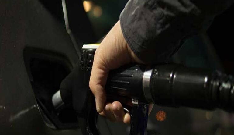 Man filling petrol on a vehicle